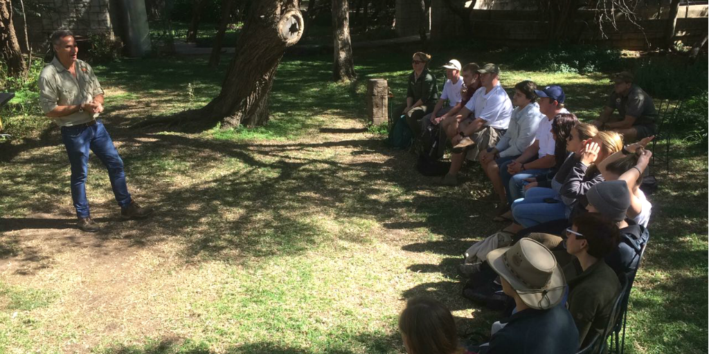 Bushwise students attending an outdoor lecture.