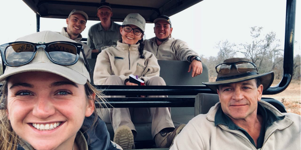 Bushwise students in a safari vehicle with a Bushwise staff member in the drivers seat.
