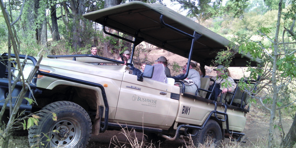 Field guides taking tour in vehicle