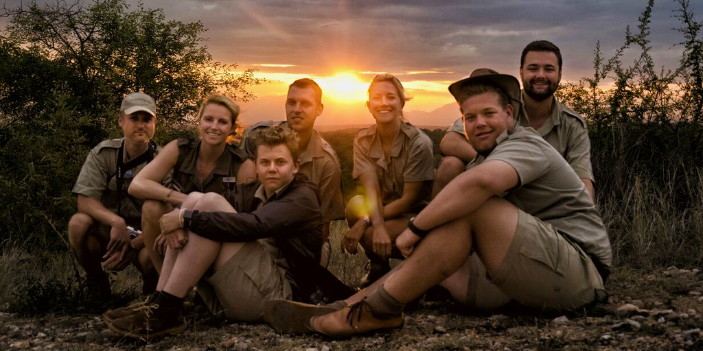 Group photo under the sun set
