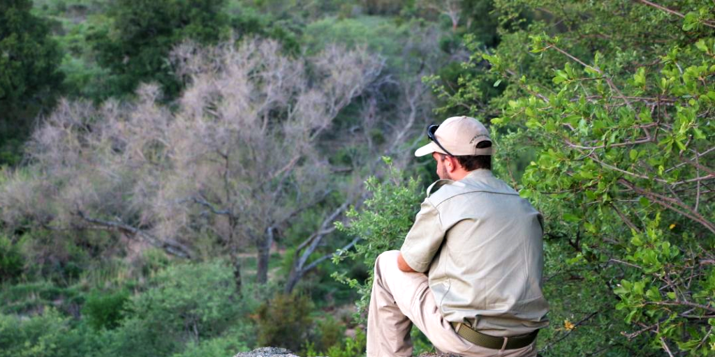 Bushwise field guide student sitting in nature.