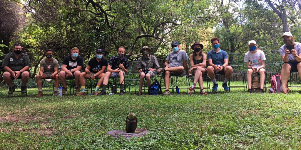 Field guides sit in a viewing potentially dangerous animals course
