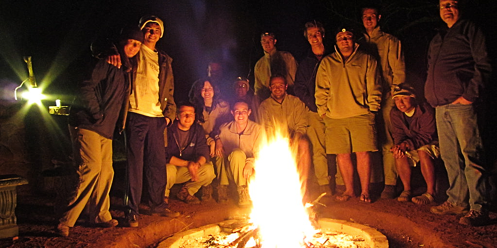 Field guides keeping warm by the fire