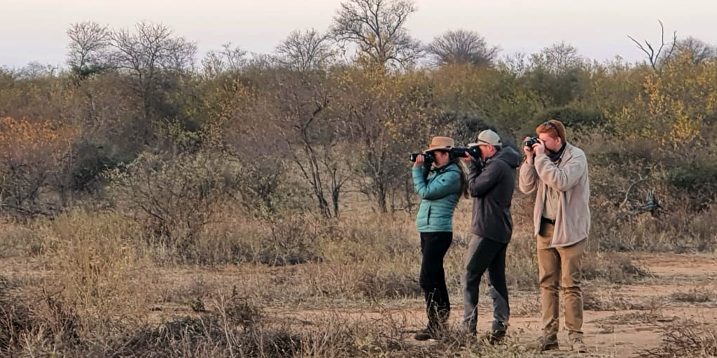 Field guides taking a photo of something in the distance